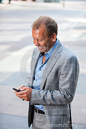 Portrait of businessman text messaging