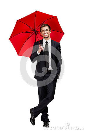 Portrait of businessman with umbrella
