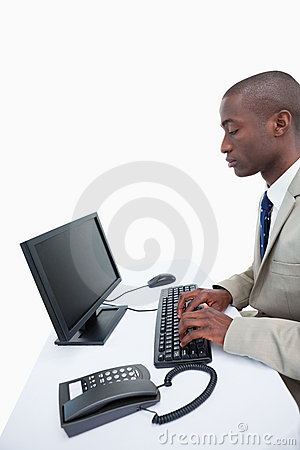 Portrait of a businessman using a computer