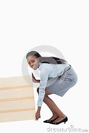 Portrait of a businesswoman dragging a panel