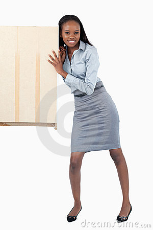 Portrait of a businesswoman pushing a panel