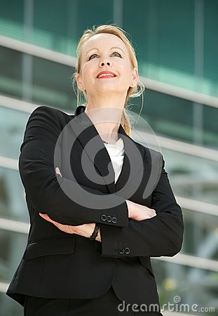 Portrait of a businesswoman standing outside offic