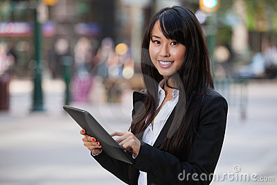 Portrait of businesswoman using tablet pc