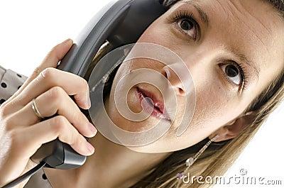 Portrait of a businesswoman using a phone handset