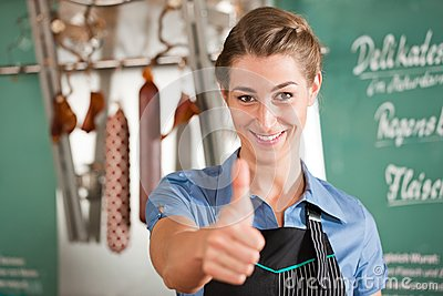 Female Butcher Showing Thumbs up