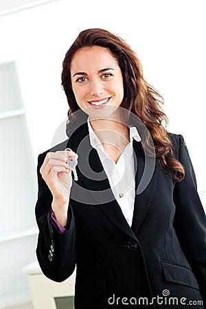 Portrait of a caucasian businesswoman holding key