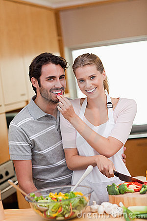 Portrait of a charming couple cooking