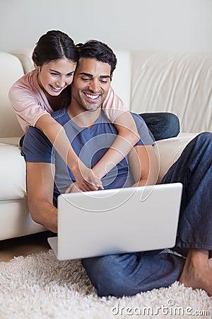 Portrait of a charming couple using a laptop
