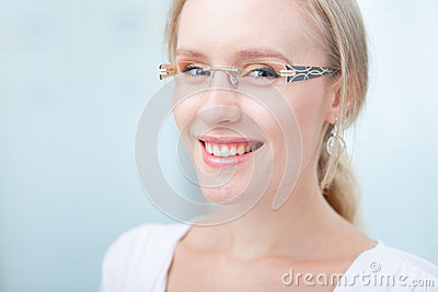 portrait of a charming young  woman with glasses