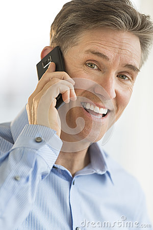 Portrait Of Cheerful Businessman Using Smart Phone
