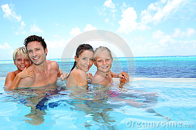 Portrait of cheerful family in swimsuit