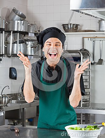 Male Chef Gesturing In Kitchen