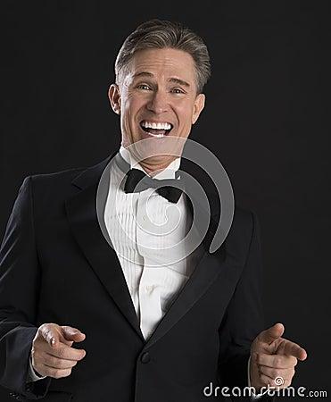 Portrait Of Cheerful Man In Tuxedo Gesturing