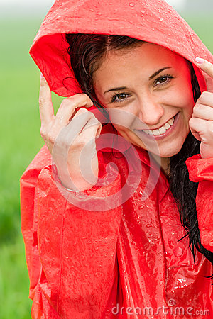 Portrait of cheerful teenager in the rain