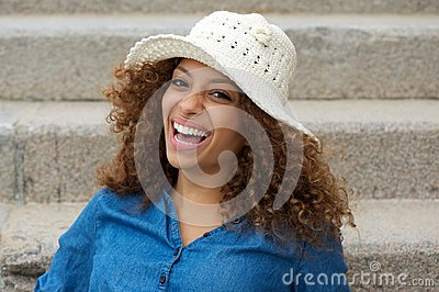 Portrait of a cheerful young lady laughing