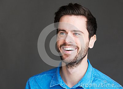 Portrait of a cheerful young man laughing