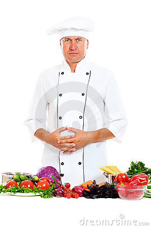 Portrait of chef with bright food