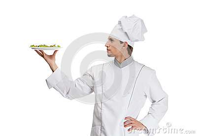 Portrait of chef cook with salad dish
