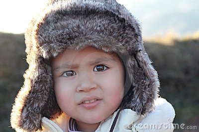 Portrait of a child with fur hat