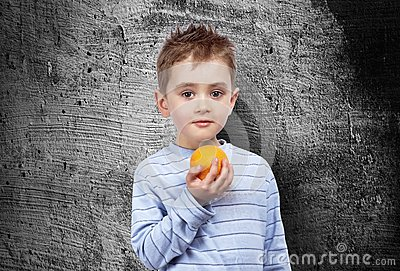 Portrait of a child with an orange
