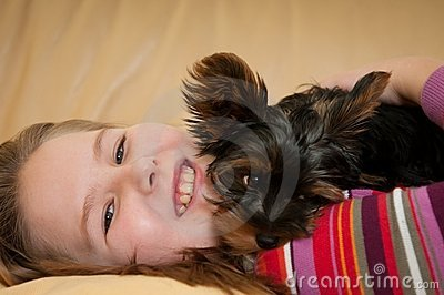 Portrait of child playing with dog
