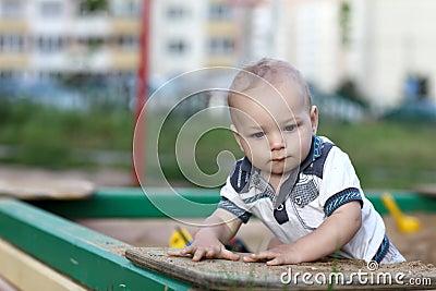 Portrait of child in sandbox