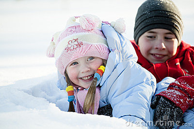 Portrait of children playing in the snow