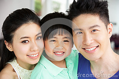 Portrait Of Chinese Family Together At Home