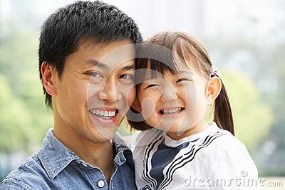 Portrait Of Chinese Father With Daughter In Park