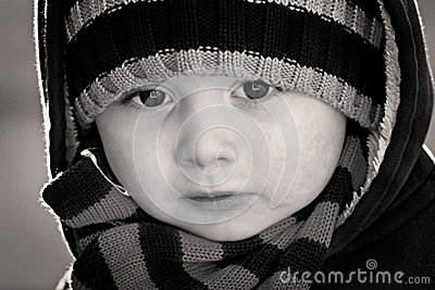 Portrait close up of boy in black and white