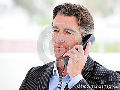 Portrait of a confident businessman on phone