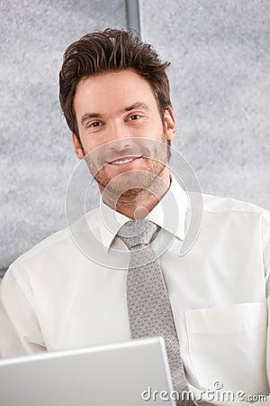 Portrait of confident businessman smiling Stock Photo