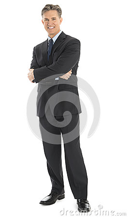 Portrait Of Confident Businessman Standing Arms Crossed