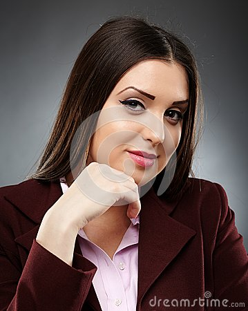 Portrait of a confident businesswoman with hand on chin