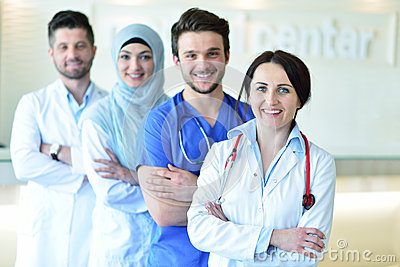 Portrait of confident happy group of doctors standing at the medical office Stock Photo