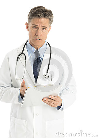 Portrait Of Confident Male Doctor Gesturing At Clipboard