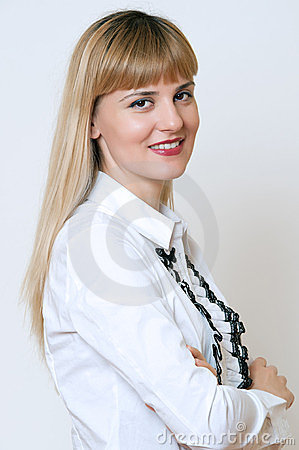 Portrait of a confident young business lady standing with folded