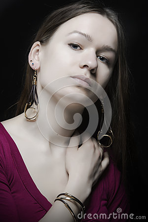 Portrait of confident young girl with jewellery