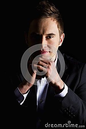 Portrait of content businessman.