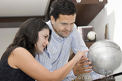Portrait of couple planning vacation