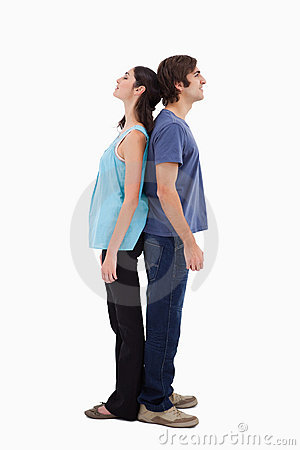 Portrait of a couple standing back to back