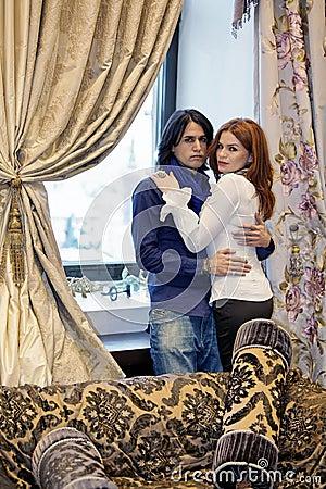 Portrait of couple beside window