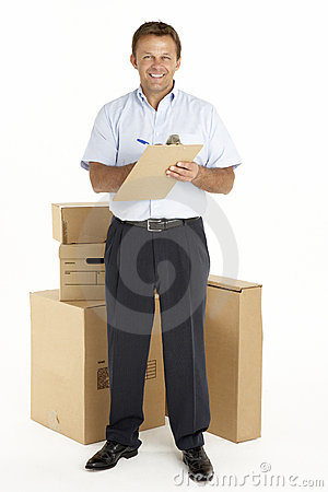 Portrait Of Courier Standing Next To Parcels