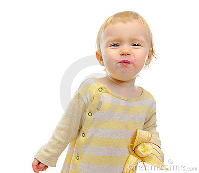 Portrait of cute baby girl  eating banana