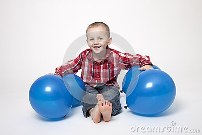 Portrait of cute boy with blue balloons