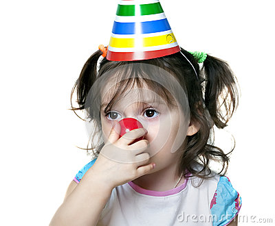 Portrait of cute brunette baby girl as a clown
