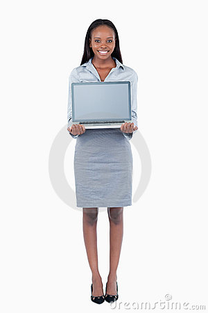 Portrait of a cute businesswoman showing a laptop