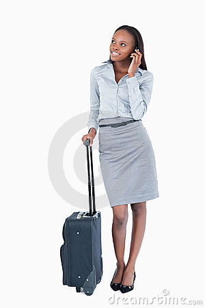 Portrait of a cute businesswoman with a suitcase