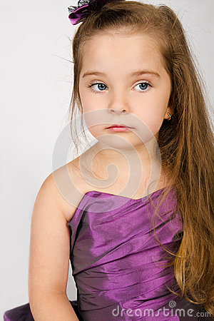 Portrait of cute little girl in princess dress