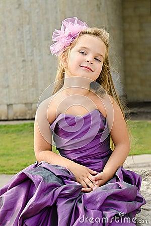 Portrait of cute little girl in princess dress